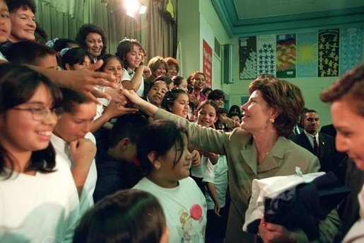 Laura Bush greets student of Morningside Elementary School after addressing the assembly in San Fernando, Calif., March 22, 2001. White House photo by Paul Morse.