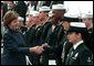 Laura Bush greets sailors aboard the USS Shiloh during a Troops to Teachers recruitment event in San Diego, March 23, 2001. White House photo by Paul Morse.