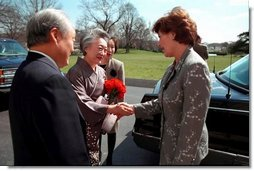 Laura Bush greets Ambassador and Mrs. Shunji Yanai of Japan before departing for the 2001 Cherry Blossom Festival March 25, 2001.  White House photo by Paul Morse
