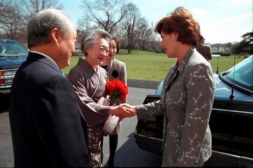Laura Bush greets Ambassador and Mrs. Shunji Yanai of Japan before departing for the 2001 Cherry Blossom Festival March 25, 2001. White House photo by Paul Morse.