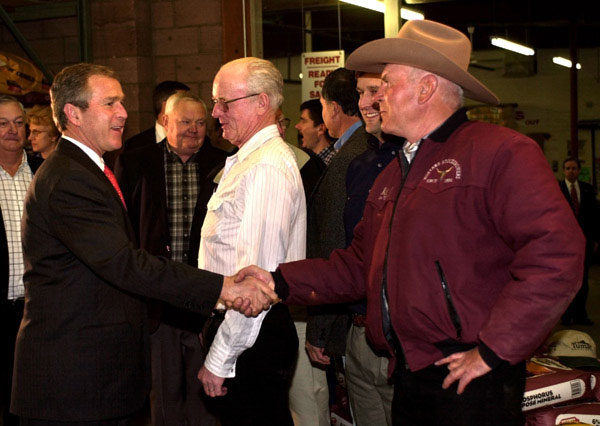 President George W. Bush greets farmers before a meeting with Montana Agricultural Producers at Tractor Supply Company in Billings, Montana, Monday, March 26, 2001. WHITE HOUSE PHOTO BY ERIC DRAPER