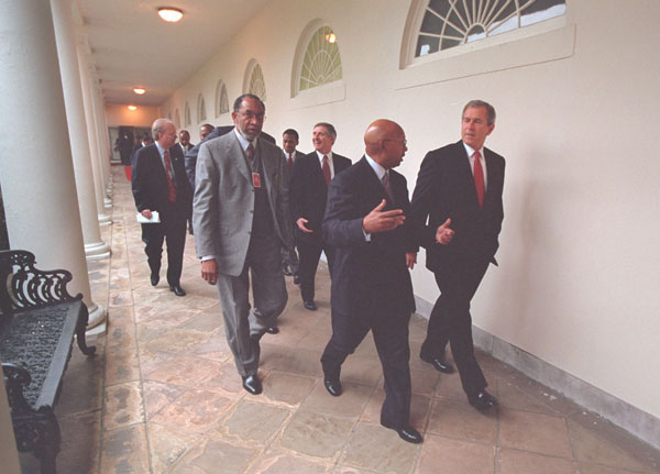 President George W. Bush escorts African American leaders through the Collonade before his speech to African American leaders in the East Room, Thursday, March 29.