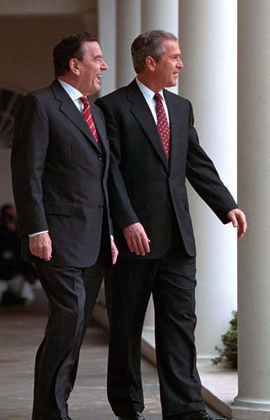 President George W. Bush walks with German Chancellor Gerhard Schroeder at the White House on Thursday March 29. 2001.