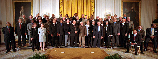 President George W. Bush poses with members of Baseball's Hall of Fame during a ceremony in the East Room of the White House on Friday March 30, 2001.