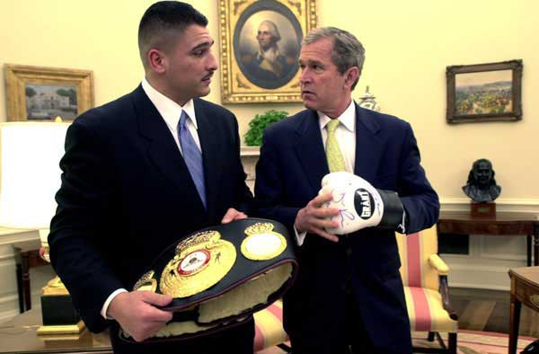 President George W. Bush and Boxer Johnny Ruiz look at a boxing glove and the World Boxing Association Heavyweight Championship belt inside the Oval Office, Thursday, March 15.
