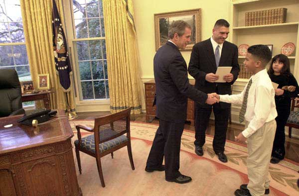 President George W. Bush meets the 11-year-old Johnny, son of boxer Johnny Ruiz, center, inside the Oval Office, Thursday, March 15. Also pictured is Ruiz daughter, Jocelyn, age 8.