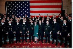 Mrs. Bush poses with the members of the U.S. Naval Academy Men's Glee Club during the Senate Spouses luncheon at the U.S. Capitol April 3, 2001.  White House photo by Susan Sterner