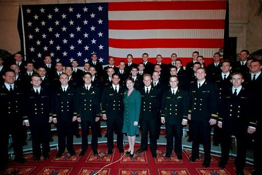 Mrs. Bush poses with the members of the U.S. Naval Academy Men's Glee Club during the Senate Spouses luncheon at the U.S. Capitol April 3, 2001. White House photo by Susan Sterner.