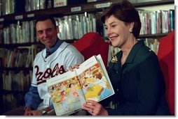 "Laura Bush and Baltimore Orioles shortstop, Mike Bordick, read to children at the Washington, D.C. Public Library, Northeast Branch, as part of ""Celebrate National Library Week at your Library"" April 3, 2001.  White House photo by Eric Draper"