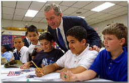President George W. Bush talks with students at B.W. Tinker School in Waterbury, Connecticut on April 18, 2001.