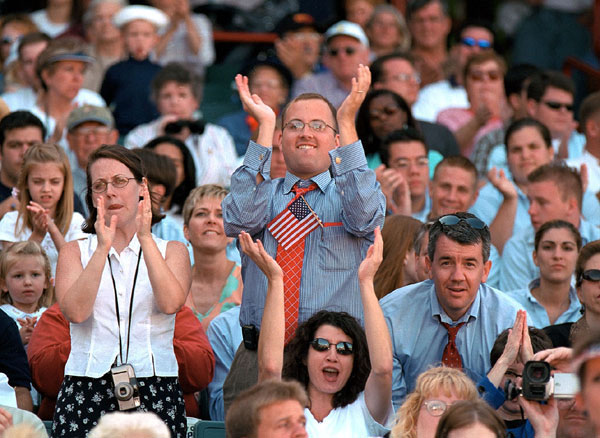An enthusiastic crowd greets President Bush's remarks about tax relief at Zephyr Field in New Orleans, Louisiana.