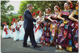 President George W. Bush greets dancers before their performance during Cinco De Mayo festivities at the White House Friday, May 4. WHITE HOUSE PHOTO BY ERIC DRAPER