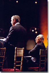 President George W. Bush speaks during the Jewish Committee dinner as Israeli Prime Minister Shimon Peres looks on Thursday night, May 3, in Washington, D.C. WHITE HOUSE PHOTO BY PAUL MORSE