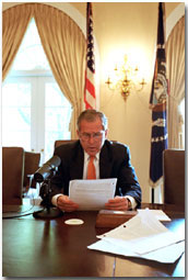 President George W. Bush records the weekly radio address for Cinco de Mayo in the Cabinet Room. This is the first time that a president has recorded the radio address in Spanish and in English. WHITE HOUSE PHOTO BY ERIC DRAPER