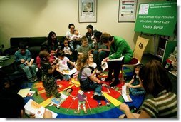 "Laura Bush reads ""The Very Hungry Caterpillar"" to children in the Pediatric Unit of Chicago Hospital during a visit to promote Reach Out and Read Programs in Chicago, Illinois, May 14, 2001.  White House photo by Paul Morse"