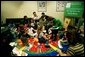"Laura Bush reads ""The Very Hungry Caterpillar"" to children in the Pediatric Unit of Chicago Hospital during a visit to promote Reach Out and Read Programs in Chicago, Illinois, May 14, 2001. White House photo by Paul Morse."