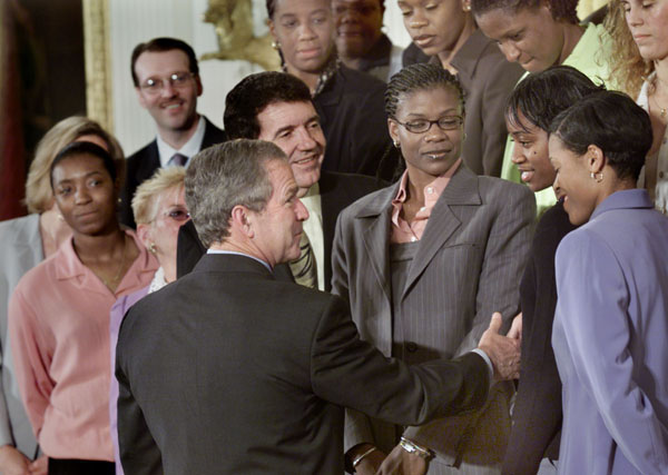 President George W. Bush greets members of the WNBA's Houston Comet's during a Photo Op in the East Room, Monday, May 14. WHITE HOUSE PHOTO BY ERIC DRAPER