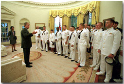 President George W. Bush talks to the crew of the VQ-1 in the Oval Office Friday, May 18. WHITE HOUSE PHOTO BY PAUL MORSE