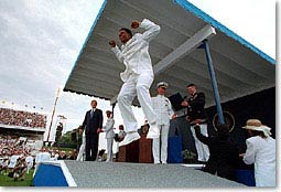 An Academy graduate leaps during graduation ceremonies. President Bush congratulated each graduate. WHITE HOUSE PHOTO BY PAUL MORSE