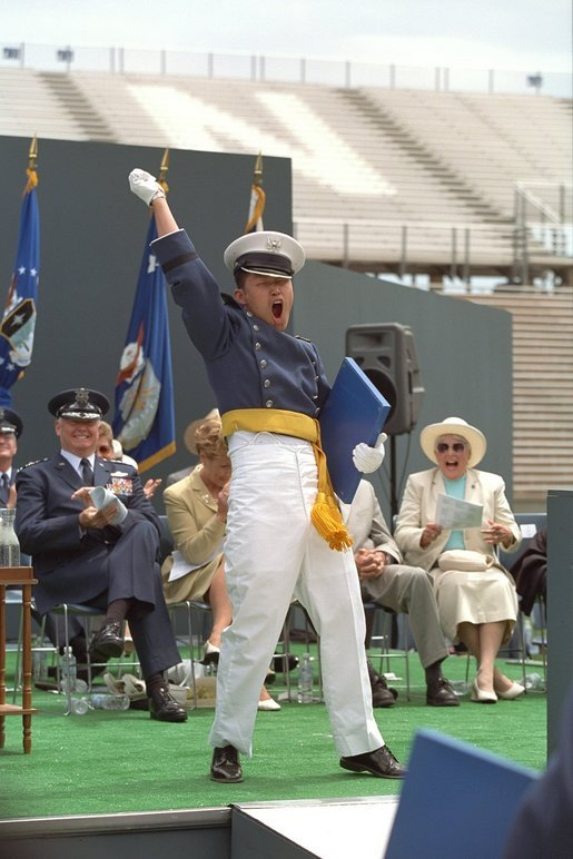 An exultant Air Force Academy graduate celebrates upon receiving his diploma during the U.S. Air Force Academy Commencement ceremonies at Falcon Stadium in Colorado Springs, CO May 30, 2001. White House photo by David Bohrer