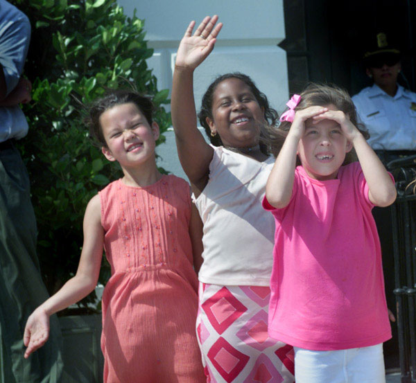 Students from The Potomac School First Grade Class reacts as Marine One departs the South Lawn following their