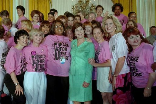 Mrs. Bush is surrounded by breast cancer survivors during a Race for the Cure event held at the White House June 1, 2001. White House photo by Susan Sterner.