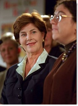 Laura Bush listens to remarks by Dr. Perri Klass during a Read Out and Read event in Boston, Mass., June 1, 2001.  White House photo by Paul Morse