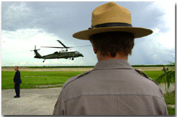 Marine One lands with President George W. Bush at Daniel Beard Center in Everglades National Park as Maureen Finnerty, Superintendent of Everglades National Park watches (Monday June 4). WHITE HOUSE PHOTO BY ERIC DRAPER