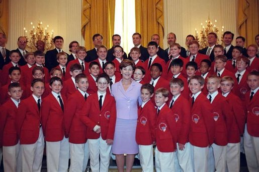 Laura Bush poses with the Philadelphia Boys Choir following their performance at the Senate Spouses Luncheon in the East Room June 4, 2001. White House photo by Susan Sterner.