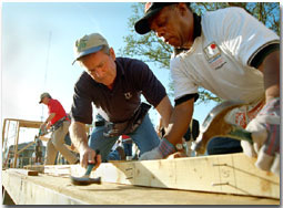 President George W. Bush works on a Habitat For Humanity house in Tampa, Fl., Tuesday, June 5.