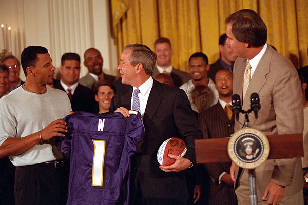 President George W. Bush accepts a jersey and football from the NFL Champion Baltimore Ravens on Thursday, June 8 at the White House. White House photo by Susan Sterner.