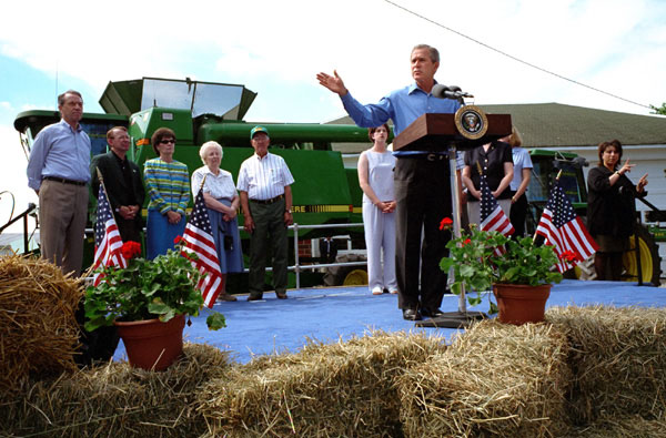 President Bush returned to Tom and Judy Barrett's farm in Dallas City, Iowa, to celebrate the tax cut Friday, June 8.