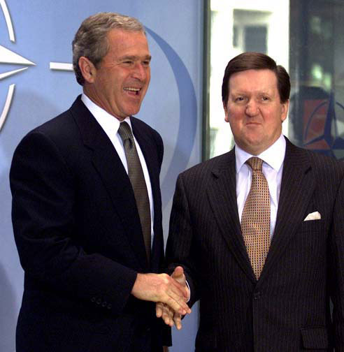 NATO Secretary-General George Robertson greets President George W. Bush at NATO headquarters in Brussels, Belgium on June 13, 2001. WHITE HOUSE PHOTO BY PAUL MORSE