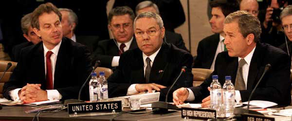 President George W. Bush speaks with Secretary of State Colin Powell, center and British Prime Minister Tony Blair at the Secretary General's office at NATO headquarters in Brussels, Belgium on June 13, 2001. WHITE HOUSE PHOTO BY PAUL MORSE