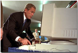 President George W. Bush tries out a computer at the Pentagon's Computer/Electronic Accommodations Program, which helps people with disabilities work and communicate better. WHITE HOUSE PHOTO BY PAUL MORSE