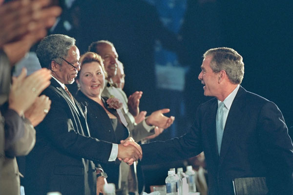 President George W. Bush shakes hands with a row of U.S. mayors including Philadelphia Mayor John F. Street after speaking at the 69th Conference of Mayors in Detroit, Michigan, Monday, June 25, 2001. WHITE HOUSE PHOTO BY ERIC DRAPER