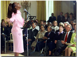 Regina Belle performs for President George W. Bush and First Lady Laura Bush during a Black Music Month celebration in the East Room of the White House on June 30, 2001. WHITE HOUSE PHOTO BY PAUL MORSE
