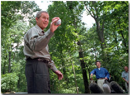 President Bush and Prime Minister Koizumi of Japan toss around a baseball for the press during a visit to Camp David June 30, 2001.