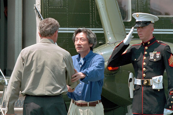 President Bush greets Prime Minister Koizumi of Japan at Camp David June 30, 2001