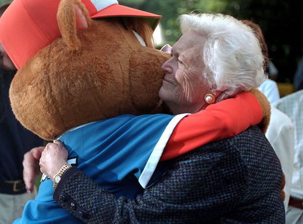 Barbara Bush hugs the Little League mascot at game's end. WHITE HOUSE PHOTO BY PAUL MORSE