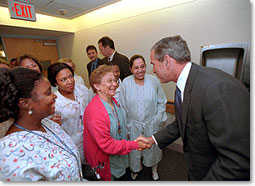 President Bush greets some of the staff and patients at Inova Fair Oaks Hospital July 3, 2001. The President and Mrs. Bush were at the hospital visiting Desiree and Stephen Sayle, who were celebrating the birth of their second daughter, Vivienne. White House photo by Eric Draper.