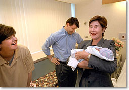 President Bush and First Lady Laura Bush visit Desiree and Stephen Sayle at Inova Fair Oaks Hospital July 3, 2001. Mrs. Sayle, who is the First Lady's Director of Correspondence, recently gave birth to her second daughter, Vivienne. White House photo by Eric Draper.