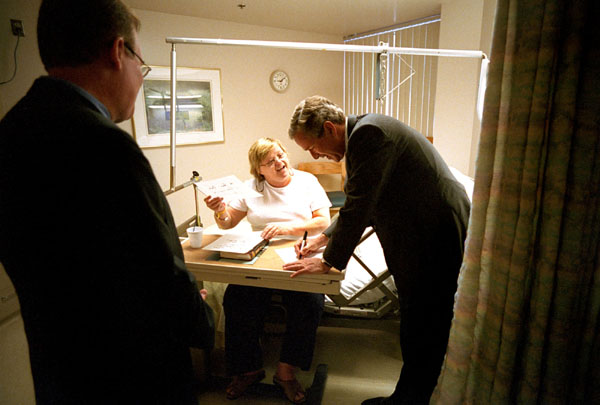 While addressing the upcoming patients' bill of rights legislation, President Bush gets a little practice signing his name while meeting patients at Inova Fair Oaks Hospital in Fairfax, VA, July 9, 2001.