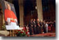 President Bush and church leaders bow their heads in prayer during congressional gold medal ceremony in honor of Cardinal O'Connor Tuesday, July 10, 2001. White House photo by Eric Draper.