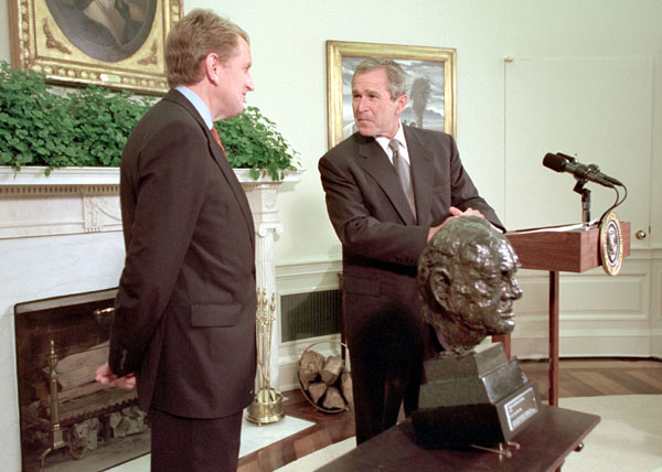 "President Bush accepts a bust of Sir Winston Churchill from ambassador of England, Sir Christopher Meyer July 16, 2001. ""He was a man of great courage. He knew what he believed. And he really kind of went after it in a way that seemed like a Texan to me,"" said the President explaining why he would like the likeness of an Englishman placed inside the Oval Offfice. ""He charged ahead, and the world is better for it."". White House photo by Paul Morse."