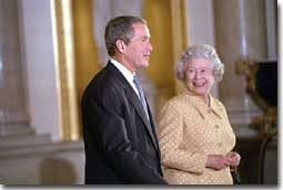Her Majesty walks with the President through Buckingham Palace July 19, 2001. White House photo by Eric Draper.