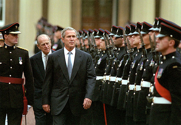 President reviews the guard during his visit to Buckingham Palace July 19, 2001. White House photo by Paul Morse.