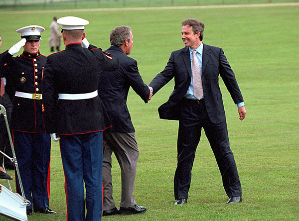 "British Prime Minister Tony Blair welcomes President Bush to Chequers in Halton, England, July 19. Like Camp David, which Mr. Blair visited in February, Chequers is a private residence for the Prime Minister where the two leaders can talk privately. ""I think it is yet another example of the strength of the relationship between our two countries. It is a very strong relationship, a very special one,"" said Mr. Blair during a press conference where he welcomed President Bush. White House photo by Eric Draper."