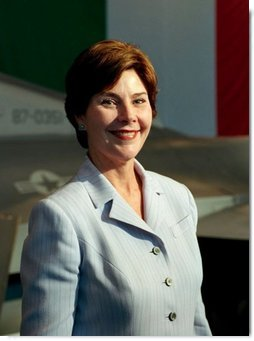 Laura Bush arrives to a Troops to Teachers meeting and rally in the Hangar One at the U.S. air base in Aviano, Italy, July 20, 2001.  White House photo by Moreen Ishikawa