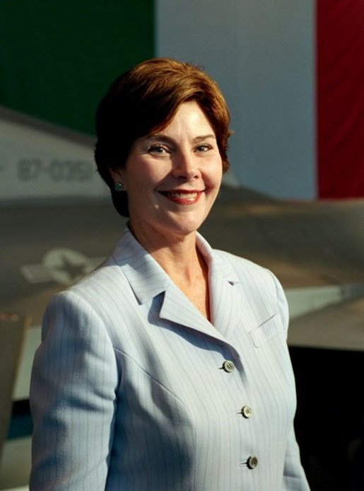 Laura Bush arrives to a Troops to Teachers meeting and rally in the Hangar One at the U.S. air base in Aviano, Italy, July 20, 2001. White House photo by Moreen Ishikawa.